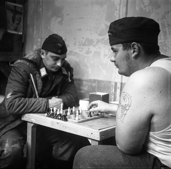German POW re-enactors playing chess  (Agfa Isolette, Tri-X)